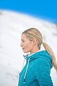 Side profile of a woman looking away, Crans-Montana, Swiss Alps, Switzerland