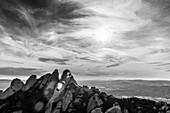Monterrat mountain peak, with a sun flare, at Montserrat Spain