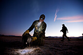 Brad Jackson foreground and Corey Funk set up goose decoys in the early morning in Carson City, NV.