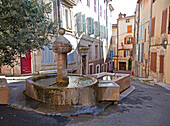 Fountain flowing into a wash tub, one of more than 40 man-made fountains in Barjols in Provence Verte. Barjols in the Var region of southern France is noted for its numerous fountains, wash houses, and old tanneries, a town shaped by water since Roman tim