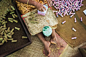 Women working in a cigarette bidi or biri factory near Kannur, Kerala, India.