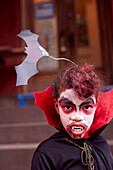 Mixed race girl wearing vampire costume