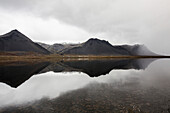Mountains reflecting in still lake