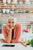 Older Caucasian woman smiling in kitchen
