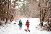 Girls walking in snowy field