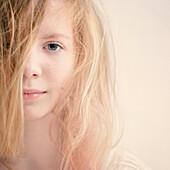 Caucasian teenage girl with messy hair