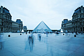 Blurred view of people outside Louvre museum, Paris, Ile-de-France, France