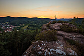 Hiker enjoying sunset upon Hockerstein, Palatinate Forest, Rhineland-Palatinate, Germany