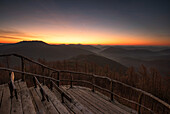 Wooden plattform at Kirschfelsen at sunrise, Palatinate Forest, Rhineland-Palatinate, Germany