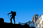 mountain climber at daybreak in front of the mont dolent, col du tour noir pass, argentiere, refuge d'argentiere, upper savoy, haute-savoie (74), rhone-alpes, france