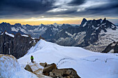 roped guide at the foot of the aiguille du midi, sunrise over the mont-blanc, chamonix-mont-blanc, upper savoy, haute-savoie (74), rhone-alpes, france