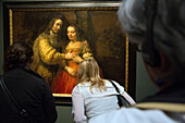 visitors at the rembrandt exhibition, the painting isaac and rebecca or the jewish bride, rijksmuseum, amsterdam, holland