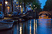 canals lit up at night, amstel, amsterdam, holland
