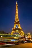 the eiffel tower illuminated at night, paris (75), france