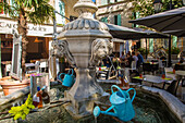 fountain and terrace of the restaurant 'a la maison', place des cordeliers, orange, vaucluse (84)