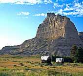 Towering eight hundred feet above the North Platte River, Scotts Bluff has been a natural landmark for many peoples, and it served as the path marker for those on the Oregon, California, Mormon, and Pony Express Trails    Scotts Bluff National Monument pr