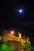 Bright moonlight over Bamburgh Castle Bamburgh, Northumberland, England