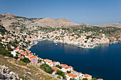 View over the harbour from hillside, Gialos Yialos, Symi Simi, Rhodes, Dodecanese Islands, South Aegean, Greece, Europe