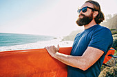 Caucasian man holding surfboard at beach