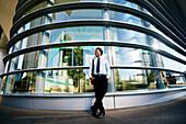 Black businessman smiling outside office building