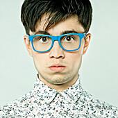 Caucasian man wearing colorful eyeglasses