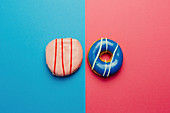 Directly above shot of donuts on colored background