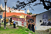 Wall paintings and musician in the Alfama, Lisbon, Portugal