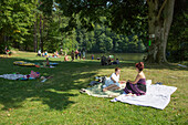 People enjoy sunny afternoon at Lake Schönsee and campground
