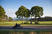 Man rides Harley-Davidson motorcycle on road near Point Alpha Memorial