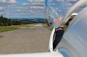 Glider airplane is launched by tow airplane at Flugplatz Wasserkuppe air field