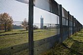 East German border observation post seen through border fence at Point Alpha Memorial
