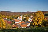 Overhead of Kleinsassen artisan village and trees with autumn foliage
