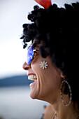 Close up profile portrait of a super fun woman.