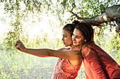 Girlfriends posing for selfie