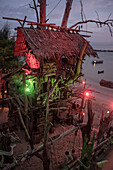 Evening lighting of the so called Hippie Bar in the shape of a pirate ship in Buffalo Bay Ao Khao Kwai, Ko Phayam, Andaman coast, Thailand, Southeast Asia