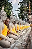 Buddhas wrapped with silk robes at Wat Yai Chai Mongkol, Ayutthaya, Thailand, Southeast Asia, UNESCO World Heritage