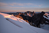 Morning dawn ascending the Barre des Ecrins with views of the Meije, Ecrins National Park, Dauphiné, France