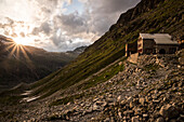 The Tschierva Hut of the Swiss Alpine Club on the base of Piz Bernina at sunset, Rhaetian Alps, canton of Grisons, Switzerland