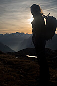 A hiker near Gufelstock, Glarus Alps, canton of Glarus, Switzerland