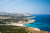 View from the summit of Mount Es Telégraf near the Cap des Freu towards the houses of Cala Mesquida and the deep blue sea, in the background the mountains of Cap Formentor, northeastern coast of Mallorca, Balearic Islands, Spain