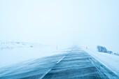 A blizzard blows snow across the street between Akureyri and Dalvík, Tröllaskagi or in English Troll Peninsula, Iceland