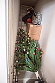 A decorated christmas tree in a store-room waiting for next christmas, Siglufjörður, Tröllaskagi or in English Troll Peninsula, Iceland