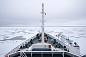 The deck of the forecastle of the tourist boat Plancius in the drift ice of the Arctic ice pack, north of Spitsbergen, Svalbard, Norway