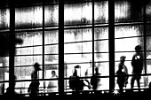 Silhouette of people at the railway station Alexanderplatz, Berlin, Germany