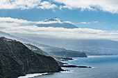 View from Mesa del Mar with the steep coast at the Teide, (3718m), landmark of the island, the highest mountain of Spain, volcano mountain, Tenerife, Canary islands, Spain