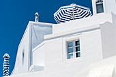 One of the typical residence buildings in the steep slope with sunshades in the dominating colours of the island blue white, Imerovigli, Santorin, Cyclades, Greece