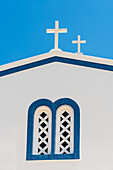 Side view with window and 2 crosses of a traditionally built blue white Greek orthodox chapel, Kamari, the Cyclades, Santorini Greece