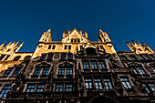 Side view city hall at Marienplatz in the light of the sunset, Munich, Bavaria, Germany