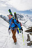 Mountain guide leading his clients on step terrain in Chamonix