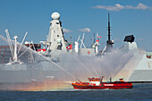 Fire brigade in front of a naval vessel at the harbour, Hamburg, Germany